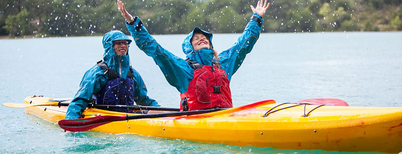 Thank you for subscribing. Two women in a canoe having fun in the rain.