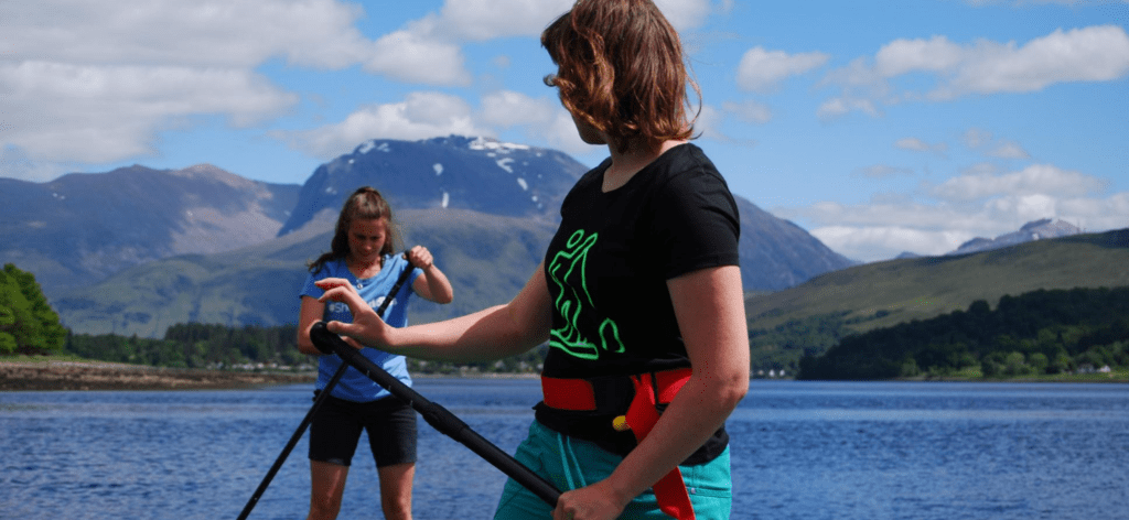 female paddling