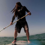 Image of Chris Jackson paddleboarding in Cornwall