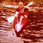 Image of Neil Boast kayaking when he was 12 years old