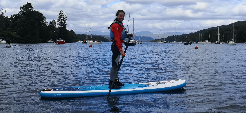 Women on paddle board on Windermere