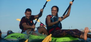 Paddlesport Instructor Courses. Image of tandem sit on top paddlers playing games