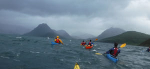 Sea Kayakers traveling in a group in shifty weather